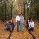 Family portraits on train tracks in Fall